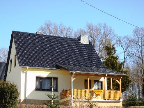 Komplettes Dach mit Holzkonstruktion über Terrasse an EFH in Schmölln